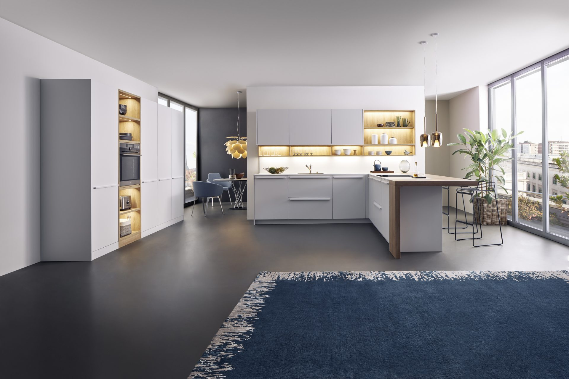 This kitchen by German supplier Leicht features two of their kitchen ranges. The first range and most of the kitchen is BONDI - a solid surface with super matt finish and an anti-fingerprint feature, in finish '103 Merino'. The second range is SYNTHIA, a wood effect laminate in finish 'Highland Oak'.