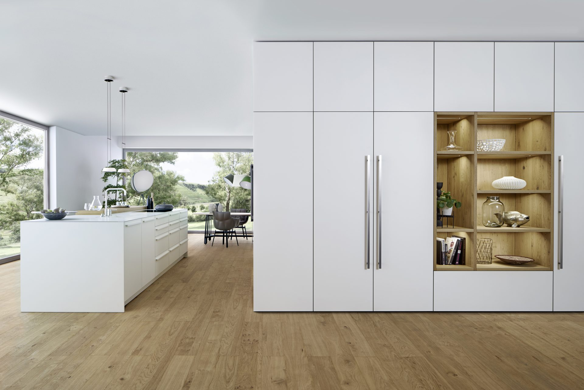 This stunning open plan kitchen by German supplier, Leicht features their BONDI-E matt lacquered doors in 'Frosty White', paired with XYLO 'Antique oak nature' range.