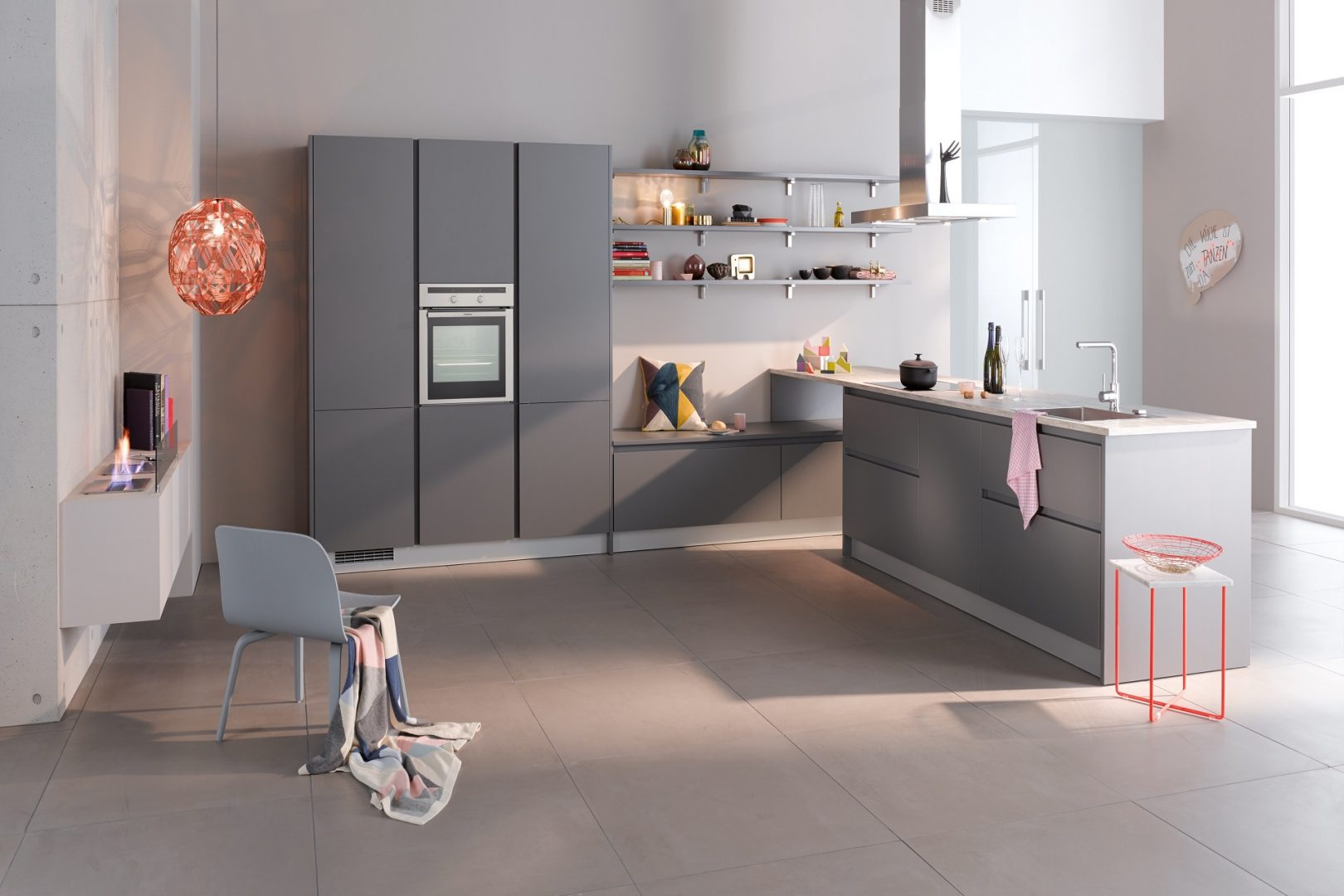 This kitchen by German supplier Brigitte features their DELTA range in finish 'Onyx Grey' laminated melamine with shaped edges on all sides.