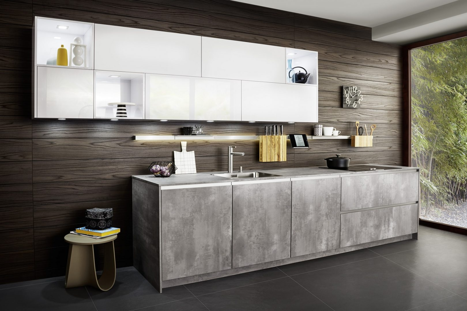 This kitchen by German supplier Leicht features two of their kitchen ranges. The mounted wall units are SIRIUS, a white high gloss lacquered door in finish '100 Arctic'. The second range is IKONO for the kitchen base units, a concrete effect laminate door in finish '202 Liton'.