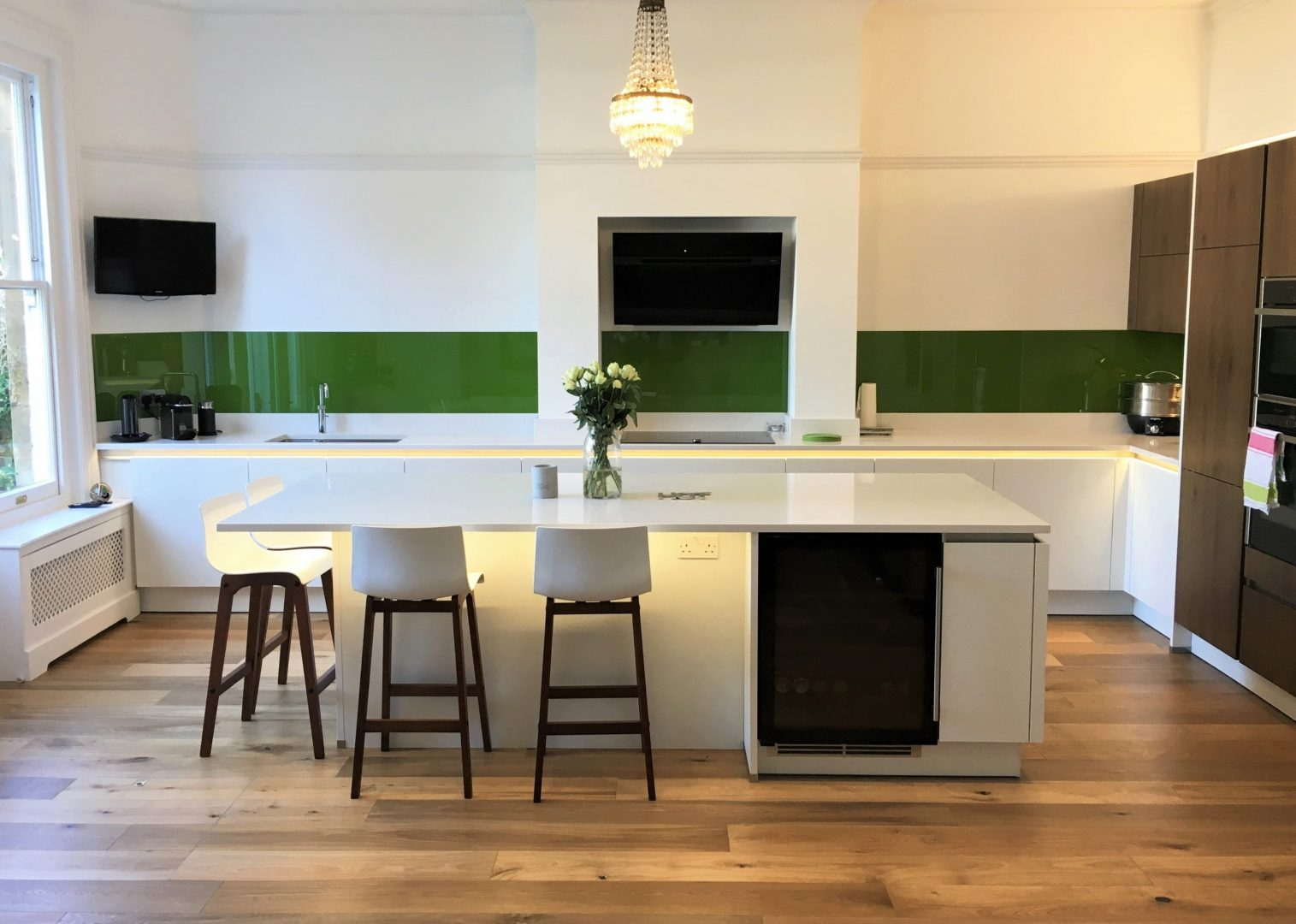 White Kitchen with Walnut Accents and Gloss White Countertops