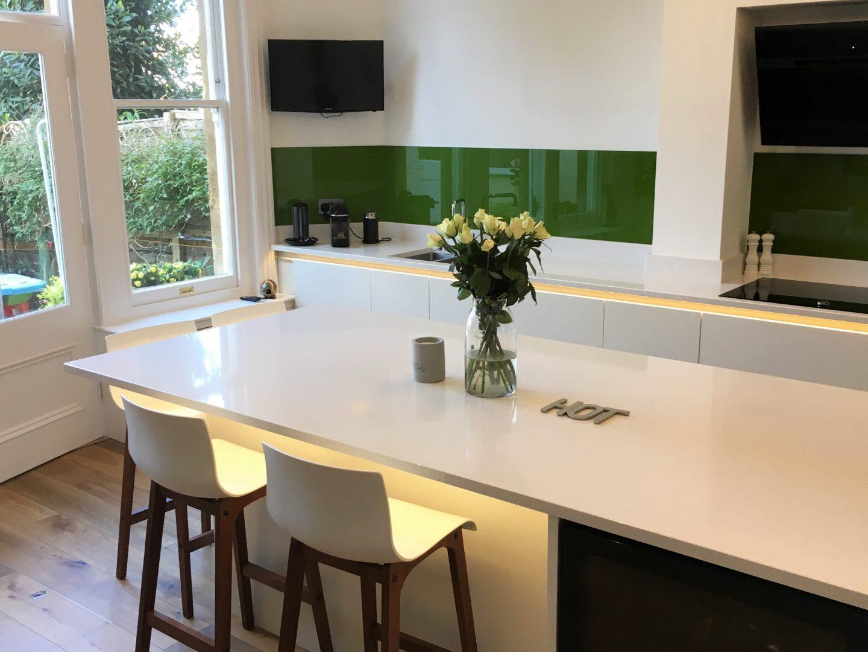 White & Walnut kitchen with green splashback