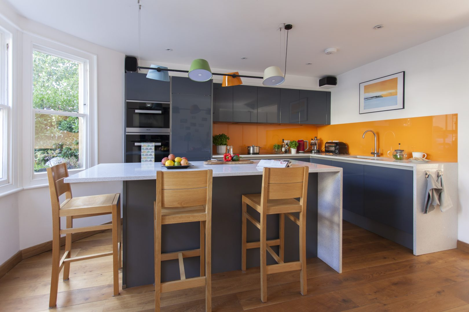 colourful quirky kitchen with orange splashback