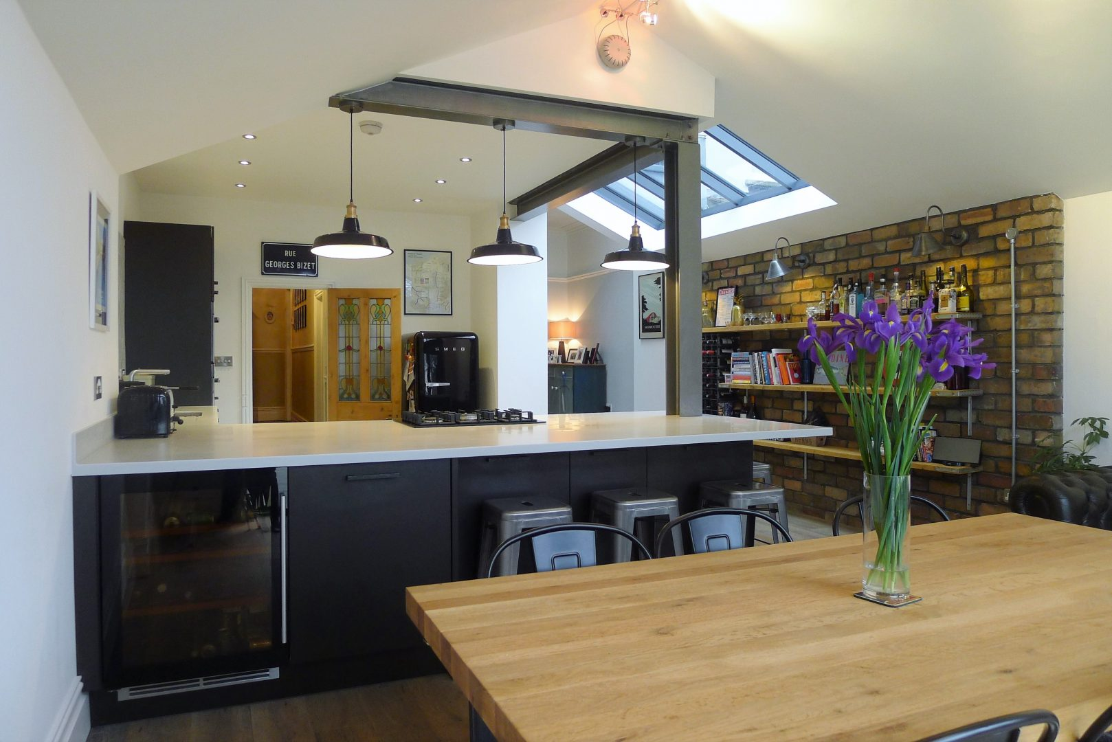 Modern Kitchen with Dark Grey Cabinets and Exposed Steel Work