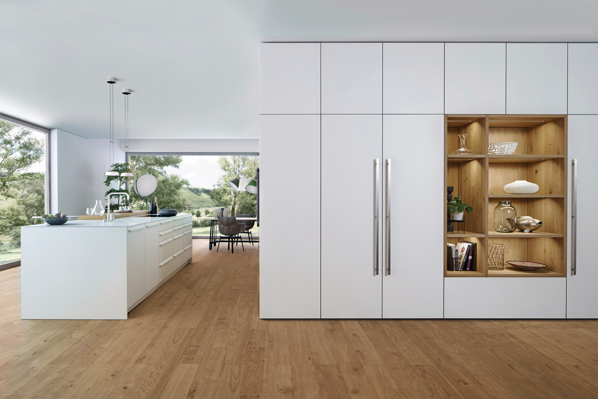 Wide Shot of White Kitchen Cabinets with Wooden Shelving