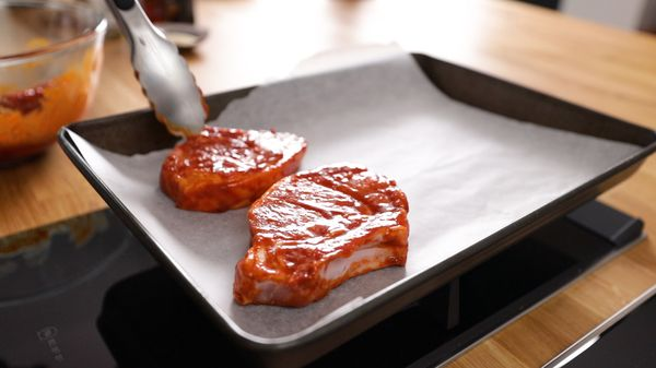 Place Korean pork chops onto baking tray to go into oven