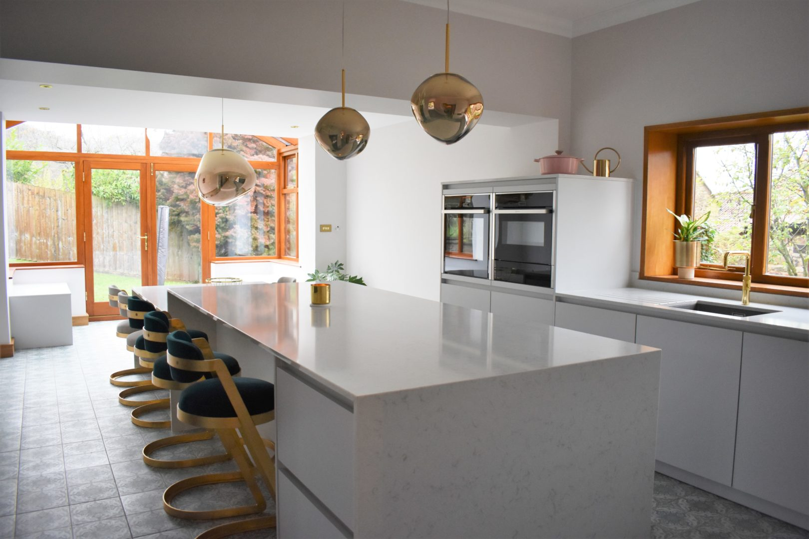 gold & silk grey kitchen with kitchen island