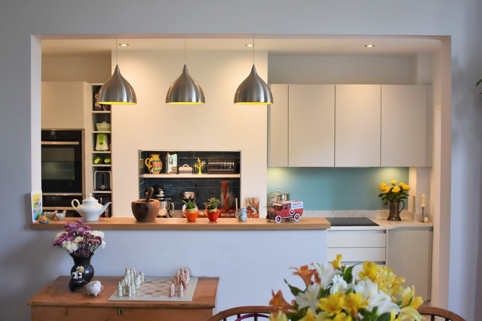 Customer Kitchen - White Minimalist Aesthetic with Silver and Wood Accents